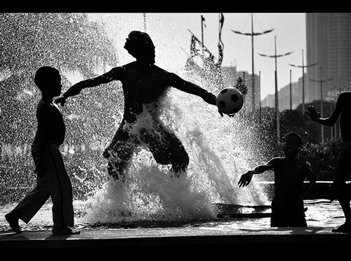 Playing in water, black and white.
