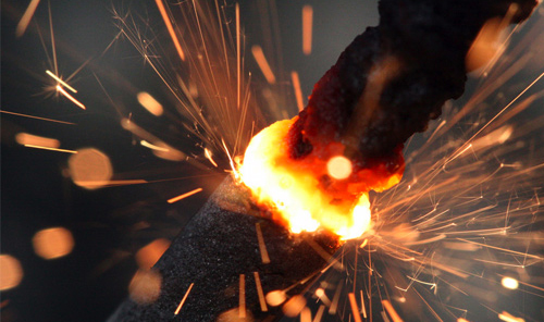 Sparks jumping from lit fuse.