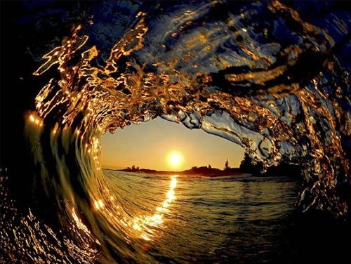 Sunset captured from inside of crashing wave.