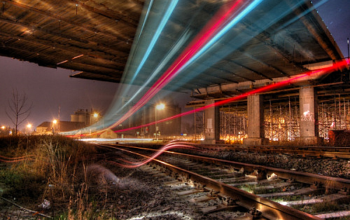 Light streaks over train tracks.